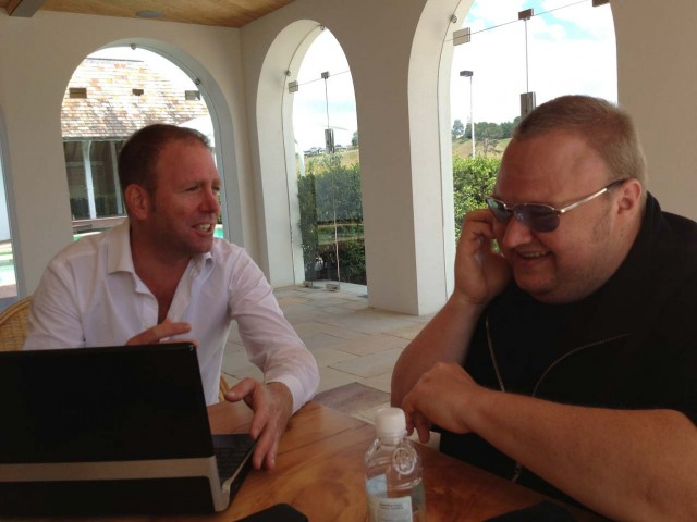 Kim Dotcom (right) shares a lighthearted moment with colleague Finn Batato.
