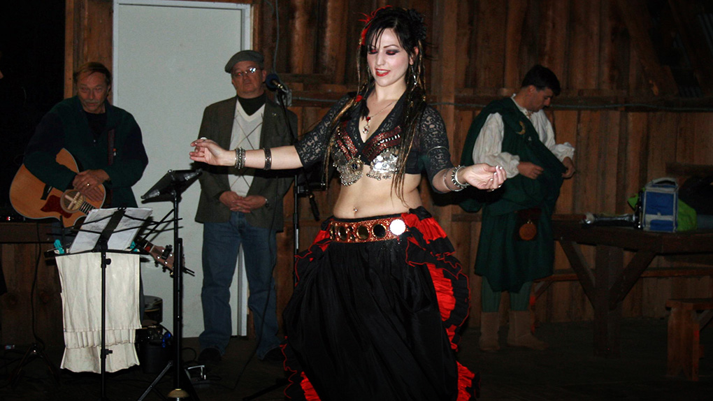 A belly dancer performs following the coronation ceremony, as Bellum Aeternus I winds down.