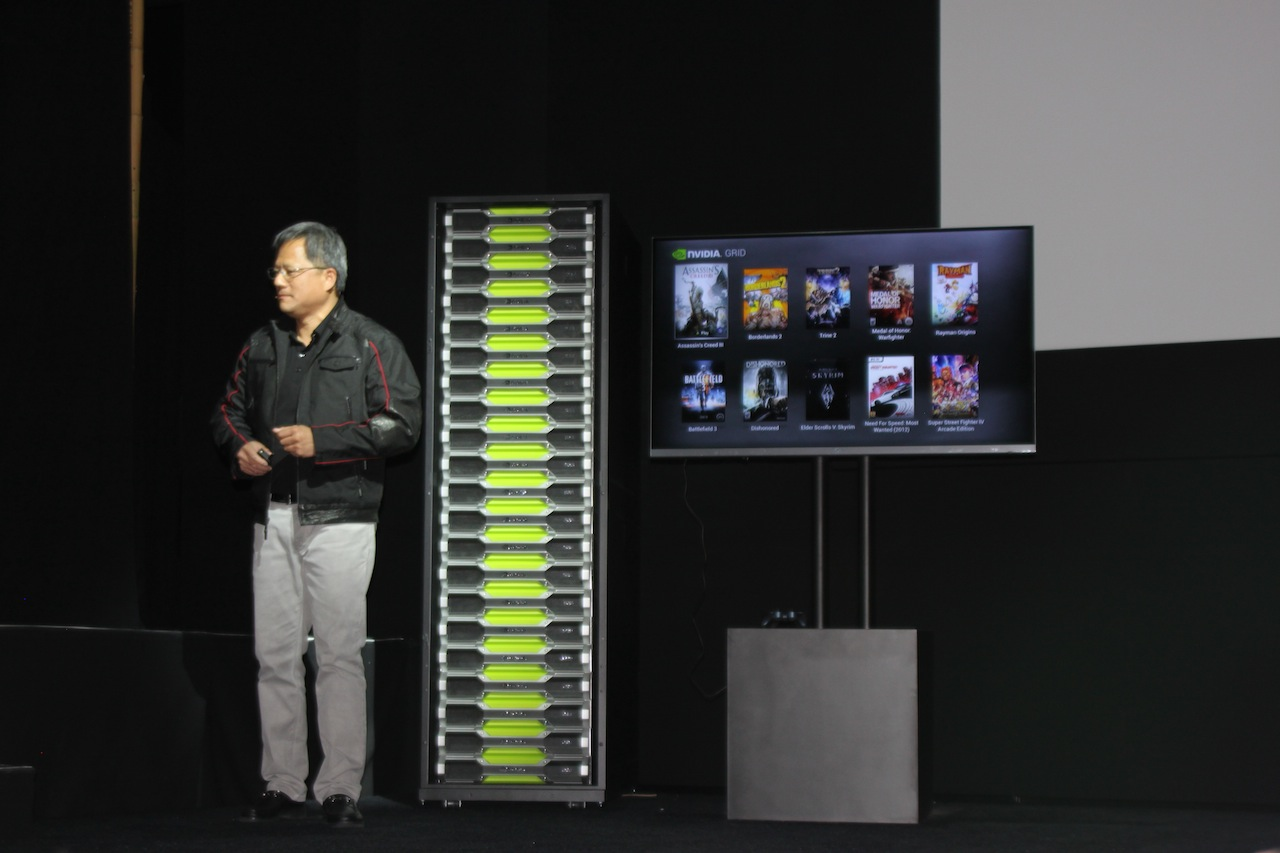 Jen-Hsun Huang next to a rack of Grid servers.