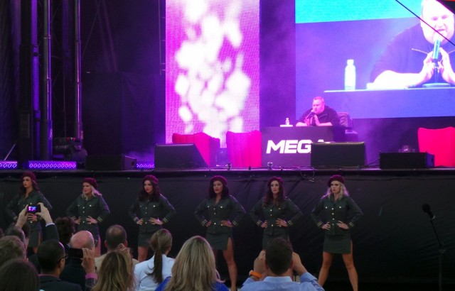 "Kim Dotcom holds forth on Mega while his sexy ""guards"" keep watch."