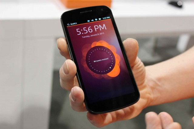 Canonical's Richard Collins holds a Galaxy Nexus running the Ubuntu phone interface.