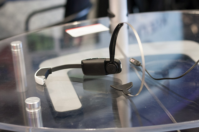 The Vuzix smart glasses attached to a headband. The product will also have options for ear clips and headbands that go around the back of the neck.