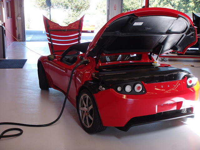 A Tesla roadster charging up.