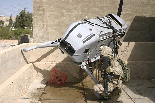 A drone that crashed on the roof of an Iraqi house is recovered by Marines in 2006.