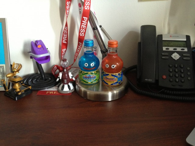 The standard array of desk junk, as captured in indoor lighting by an iPhone 4S.