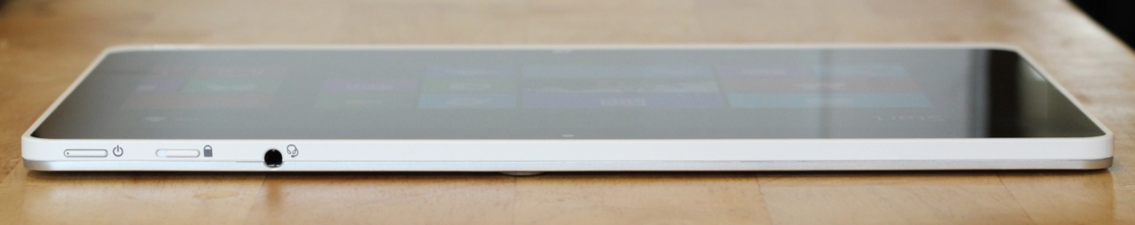 The power button, screen orientation lock, and headphone jack are on the tablet's top edge.