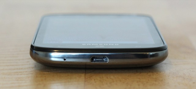 The microUSB port on the phone's bottom side.
