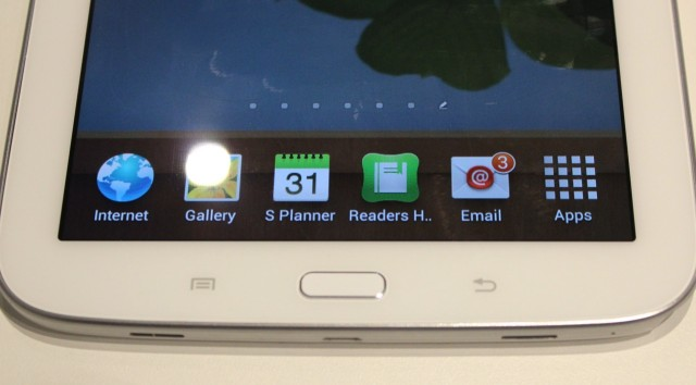 Capacitive menu and back buttons flank a hardware home button, as in Samsung's smartphones.