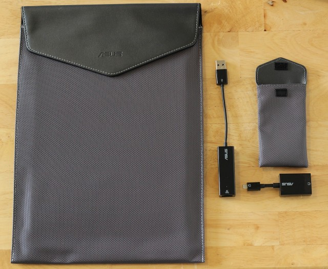 The Taichi knows how to accessorize: it comes with a stiff cloth pouch for the laptop itself, as well as a smaller pouch for the USB to Ethernet and mini VGA to VGA dongles.