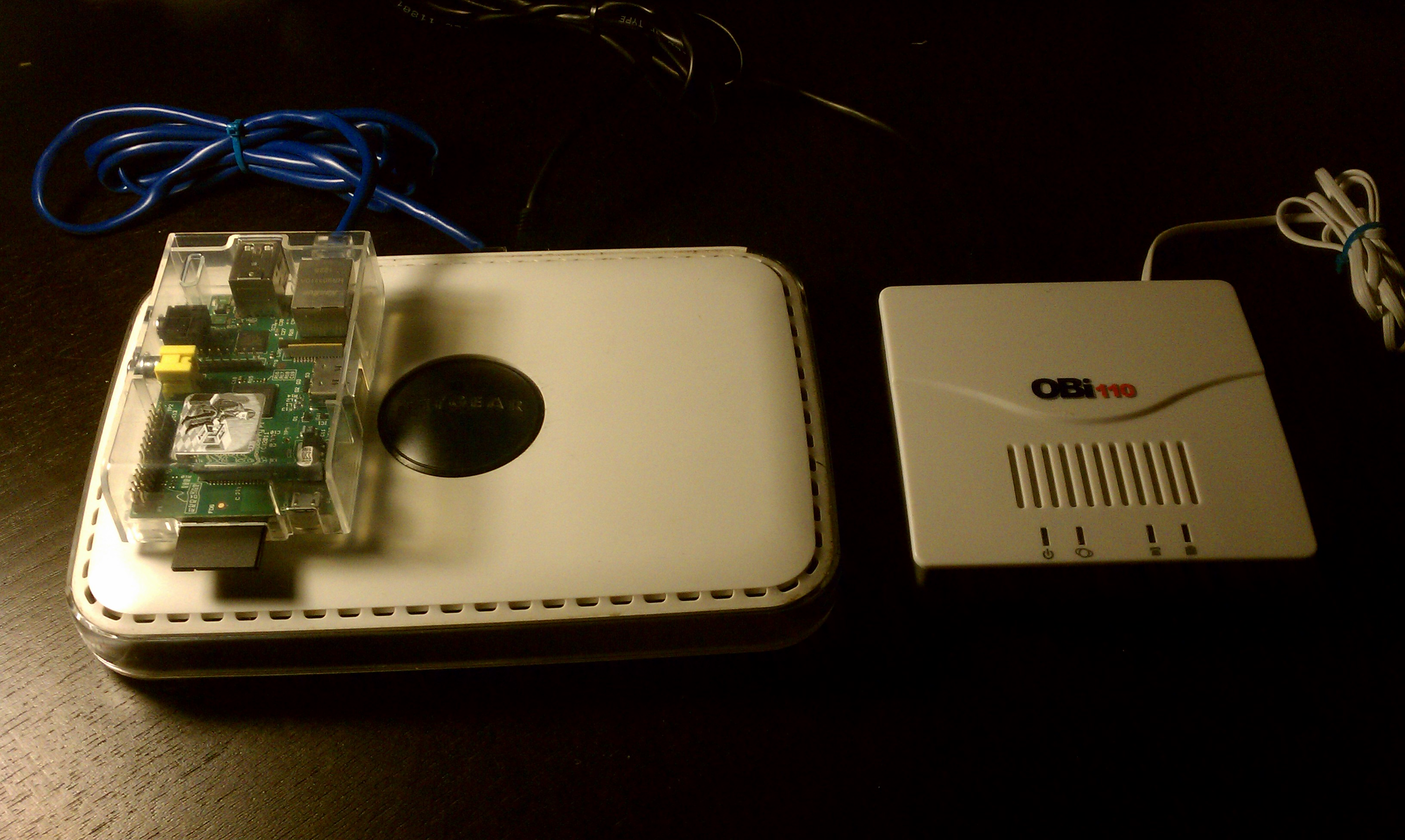 Ruiz's Raspberry Pi, a Netgear switch, and Obi110 telephone adapter.