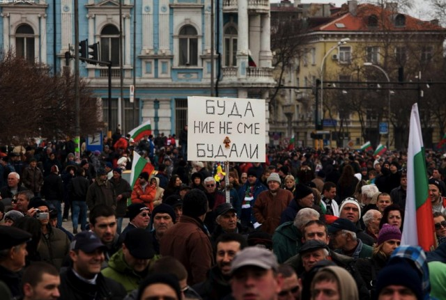 "The sign reads: ""Buddha, we're not fools."" (As seen at a February 20, 2013 protest in Sofia, Bulgaria.)"