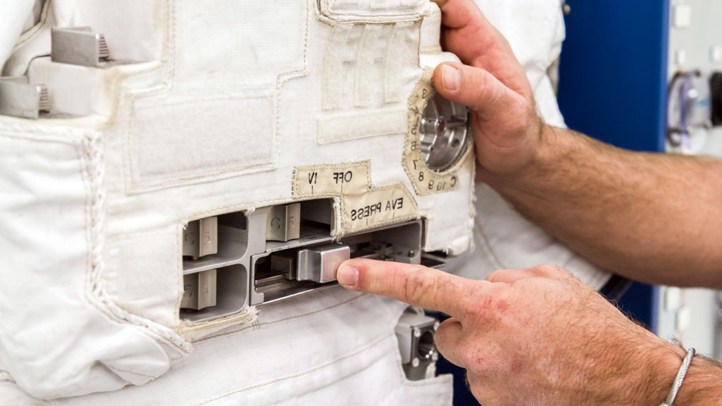Close-up of a spacesuit's display and control module (DCM). Note the backward labeling, intended to be read with the aid of wrist-mounted mirrors.