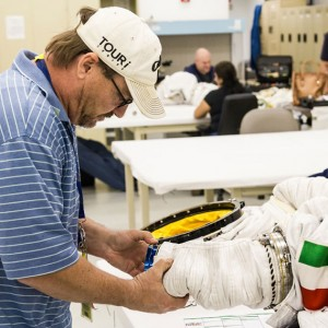 NBL suit engineer Don Smith, working on Luca Parmitano's EMU