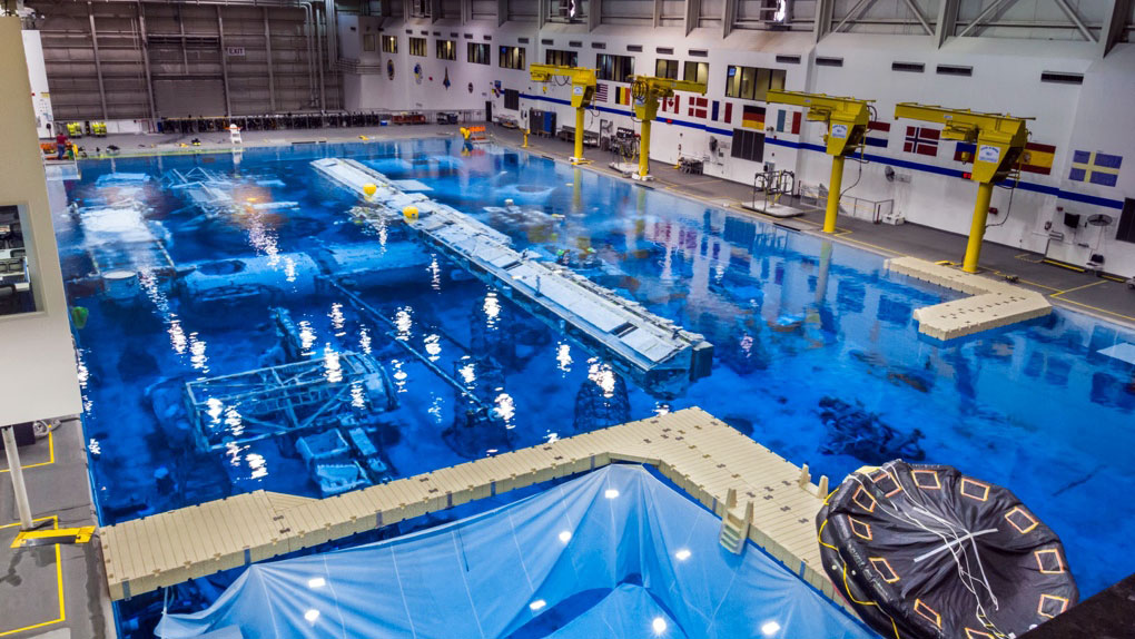 Swimming with spacemen training for spacewalks at nasa s giant pool ars technica for Largest swimming pool in the us