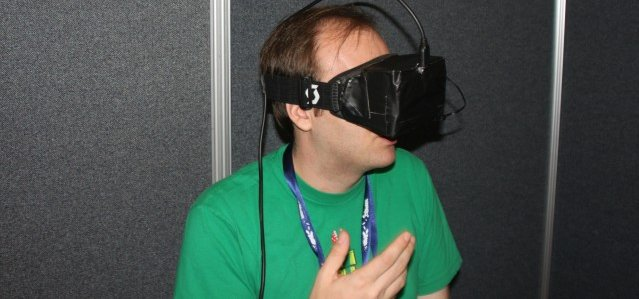 Gaming Editor Kyle Orland does his best Lawnmower Man impersonation using an early Oculus Rift in 2013.