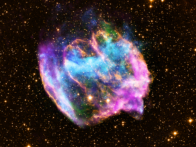 Composite X-ray/optical/radio image of the supernova remnant W49B. The structure and composition of this remnant hints that it was a gamma ray burst - one of the most violent explosions known - and likely harbors a black hole at its center.