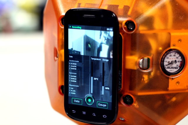The Nexus S runs an app that records activity on the gyroscope, accelerometer, and 3D compass.
