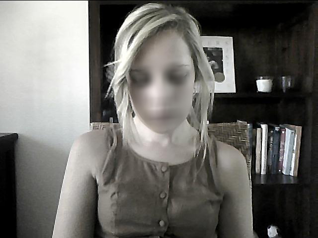 A woman unknowingly captured by her own webcam.