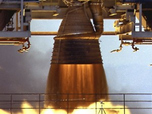 A real F-1 engine firing, from 1960. The dark jet emerging directly from the nozzle is the fuel-rich turbopump exhaust, which protects the nozzle extension from the heat of the actual rocket exhaust.