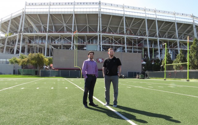 49ers CTO Kunal Malik (left) and Senior IT director Dan Williams (right) stand in front of Santa Clara Stadium.