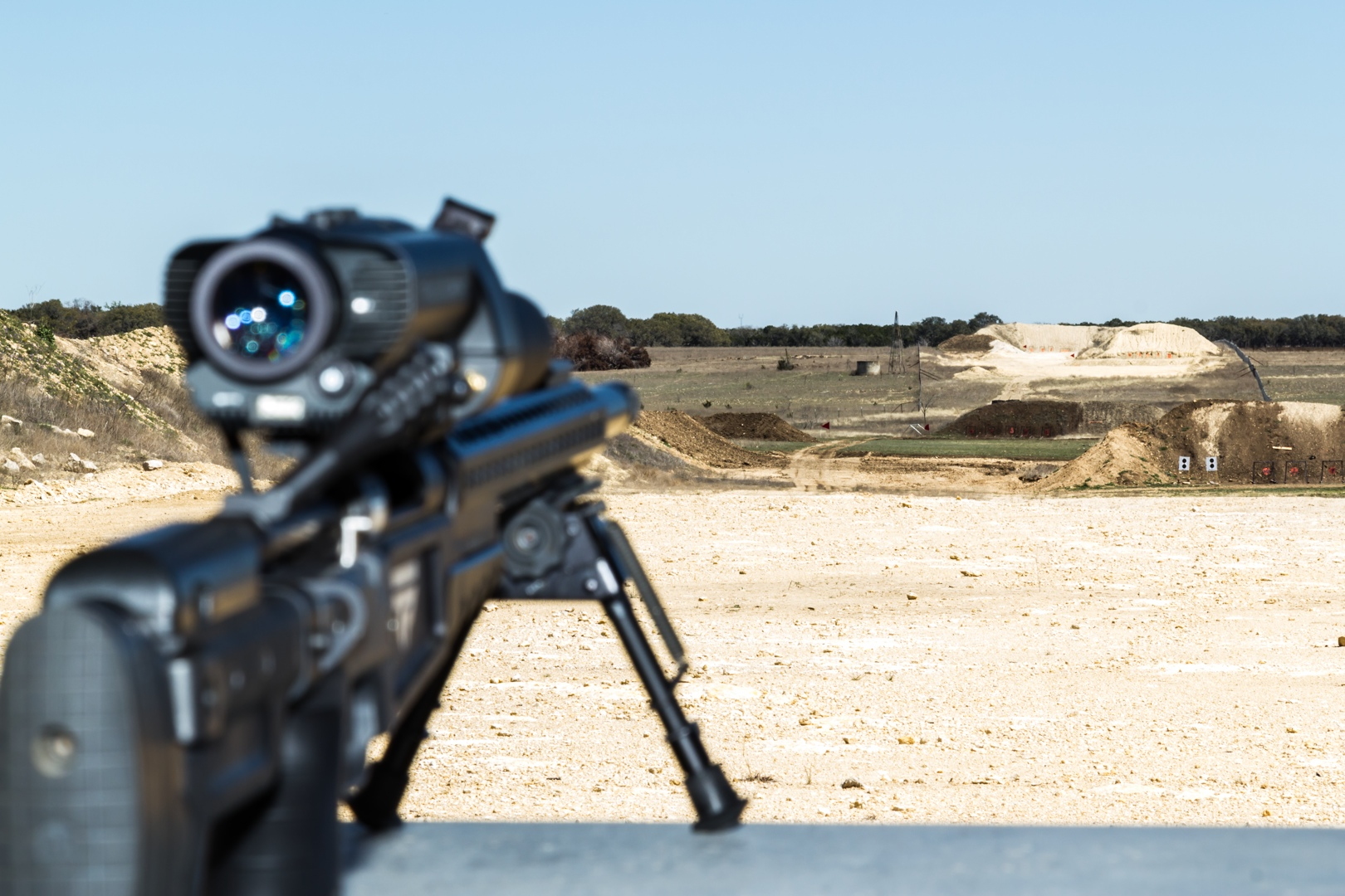 A view downrange, showing 250 yard, 500 yard, 750 yard, and 1000 yard target emplacements. At 128mm equivalent zoom, our camera's lens foreshortens the distance, making the targets appear much, much closer than they do to the naked eye.