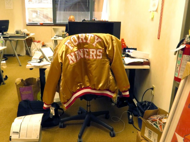 Williams, a longtime season ticket holder, keeps his 49ers jacket at his desk.