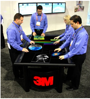 3M demos its 84-inch multitouch table prototype.