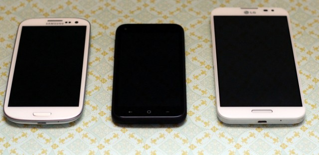 One of these things is not like the others... (Left to right: Samsung Galaxy S III, HTC First, and LG Optimus G Pro.)