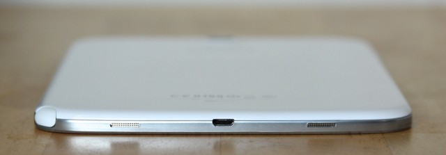 The speakers and micro-USB port on the bottom of the tablet.
