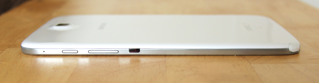 The power button, volume rocker, and IR blaster are on the tablet's right edge.