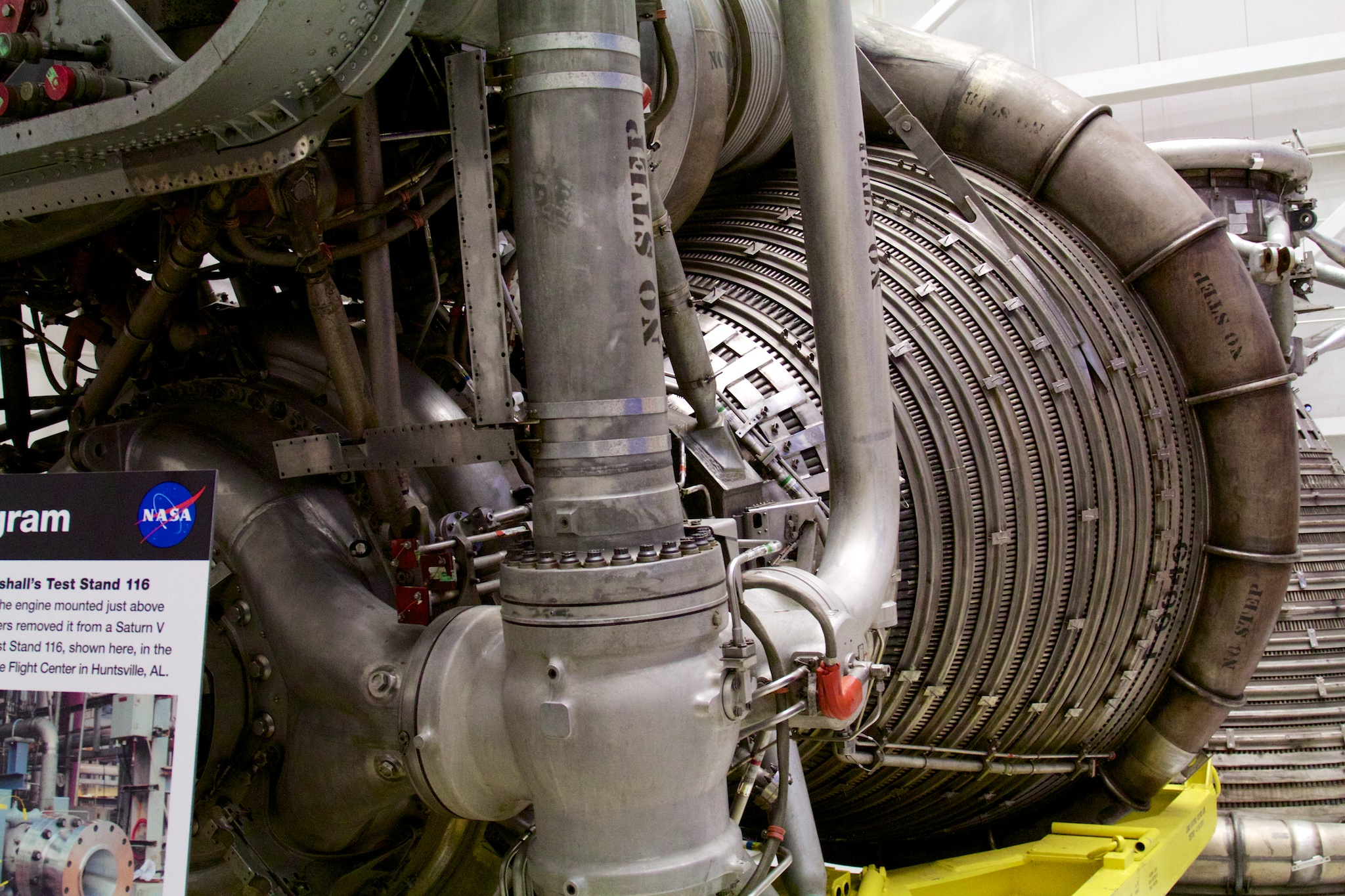 Detail on the upper thrust chamber of an Apollo-era F-1 engine. Note the tightly packed series of tubes, bound together with barrel-like hoops—these recirculate RP-1 fuel to cool the nozzle, similar to how the methane aerospike engine recirculates fuel through its plug. New engine, tried-and-true cooling strategies.