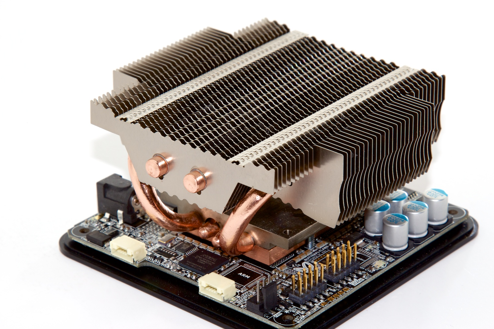Close-up of the ASIC's heat sink and some of the motherboard components.