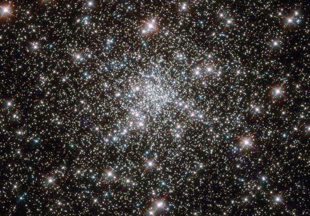 "The central region of the globular cluster NGC 6752, showing a few of the ""blue straggler"" stars. Those stars are representatives of a younger population that apparently fails to pass through an expected phase of the stellar life cycle."