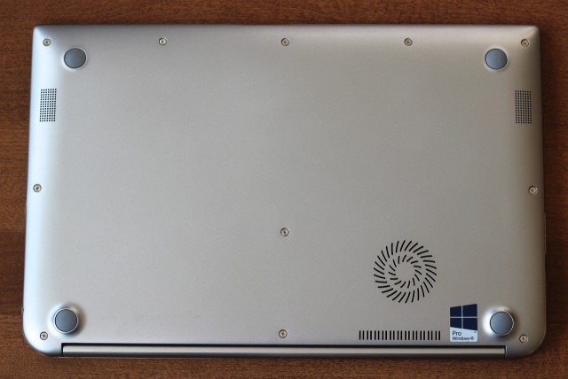 There are four rubber feet and two vents on the bottom of the laptop for the computer's single fan.