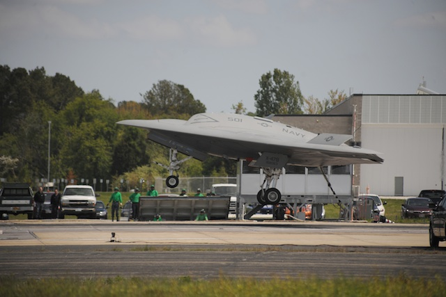"The X-47B, hook down, comes in for its first successful ""trap,"" no Goose or Maverick required."