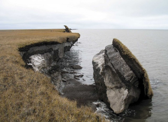 Some Alaskan permafrost tumbles into the ocean.