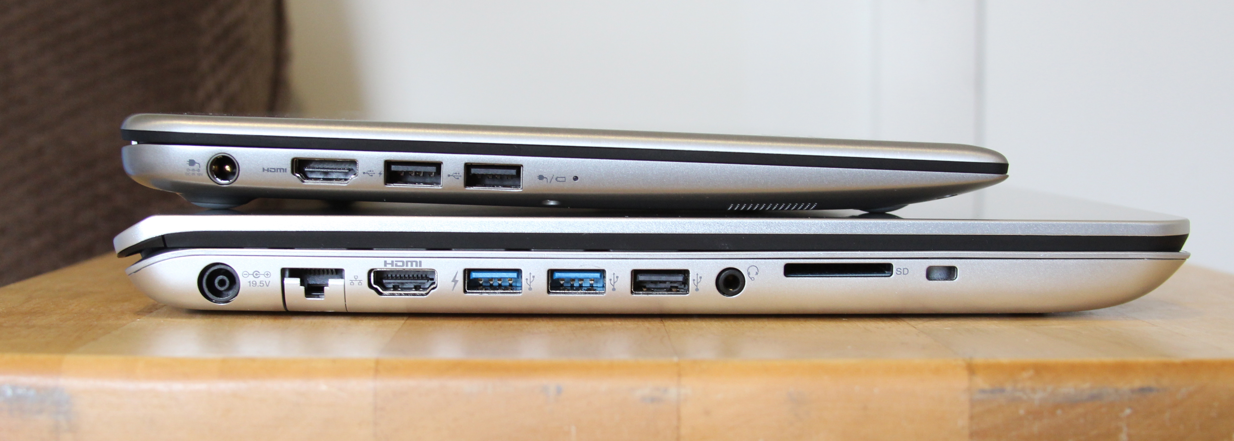 The laptops offer a fair number of ports. On the Fit 15, you get gigabit Ethernet, HDMI, two USB 3.0 ports, one USB 2.0 port, a headphone jack, a card reader, and a Kensington lock slot. Compare the thickness to Toshiba's Kirabook Ultrabook (top).