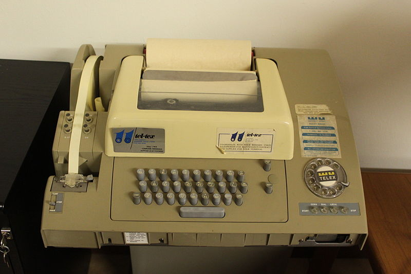 The Telex machine is kept so clean, and it types to a waking world. Still.