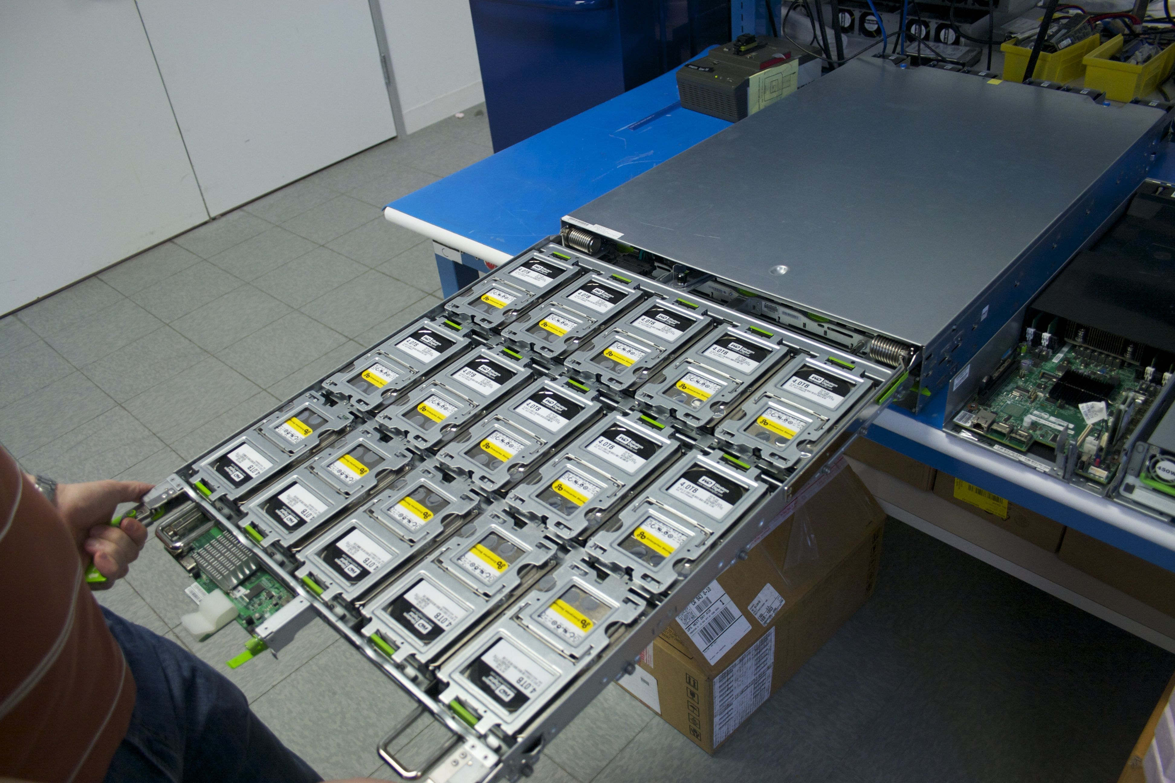 "The ""Open Vault"" storage sled, with one of its two drawers of drives extended. The drawers bend down for easy access to individual drives."