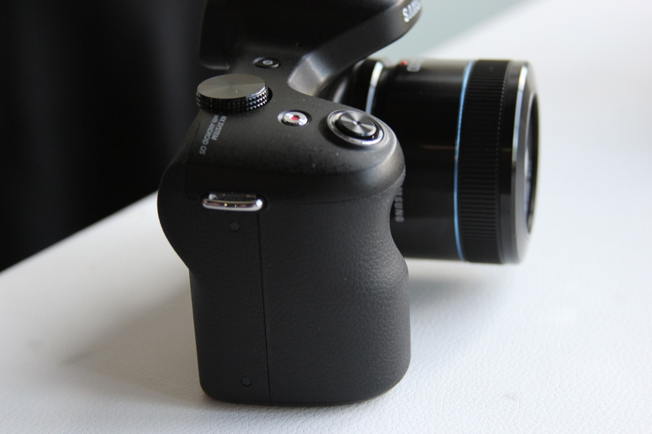 The Galaxy NX has a nice rubberized handle and the requisite camera loops (one on each side) to keep you from dropping it.
