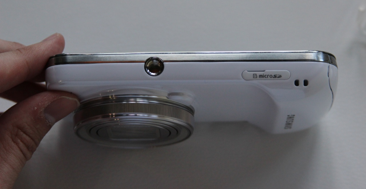A hole for a tripod and a microSD card slot are also included.
