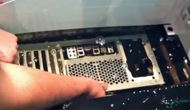 From a YouTube video showing KoreLogic's GPU-powered password cracker being dropped into a tank of mineral oil.