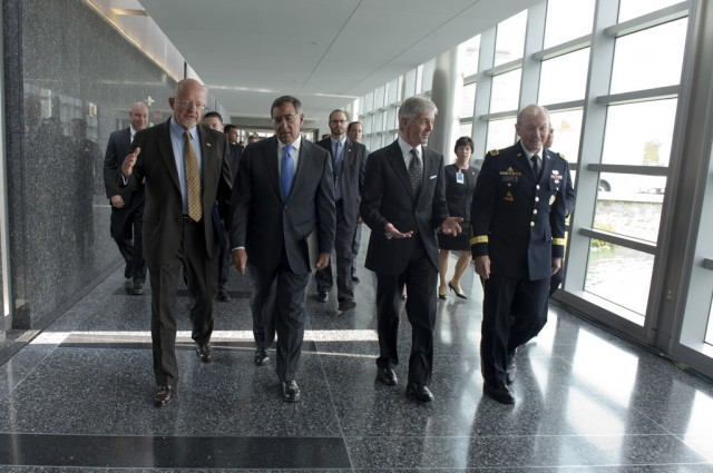 James Clapper (left, front) is the current director of national intelligence. Leon Panetta (next to Clapper), served as director of the CIA from 2011 to 2013.