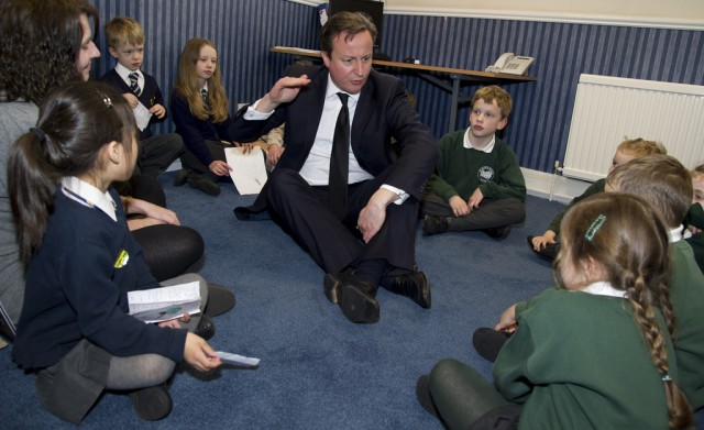 Prime Minister David Cameron speaking with children in March 2013.