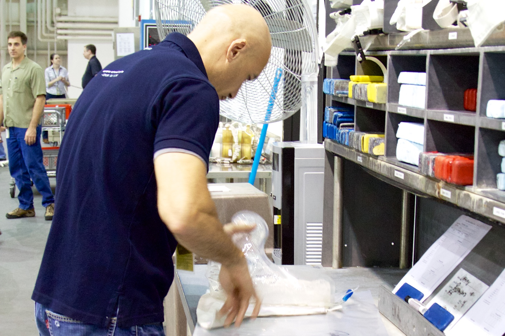 Another image of Luca Parmitano at the NBL, prepping his dive suit's drinking bag for a simulated EVA.