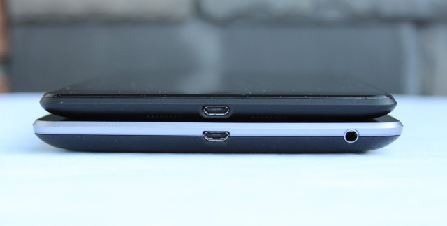 The old Nexus 7 (bottom) is decidedly huskier than the new one (top). Also note that the tablet's headphone jack has migrated to the top of the device.