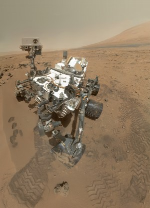 "A ""selfie"" taken by <em>Curiosity</em> (actually assembled from a mosaic of selfies). The rover captured the public's imagination with its daring, Rube Goldberg-ian <a href=""https://www.youtube.com/watch?v=h2I8AoB1xgU"">skycrane</a> touchdown on Mars."