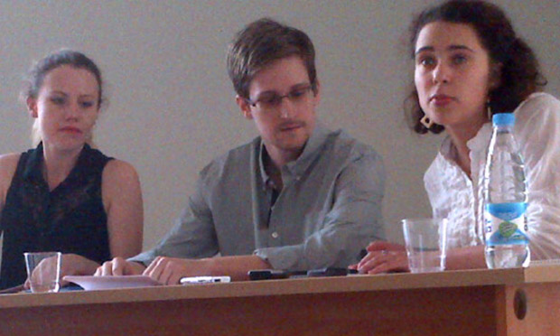 Edward Snowden in a Moscow airport. At left, Sarah Harrison of WikiLeaks.