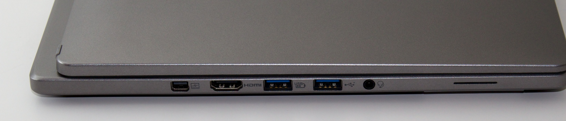 Left-side ports: headphone/line-in/mic, 2x USB 3, HDMI, and a proprietary Acer connector that looks like DIsplayPort but isn't.