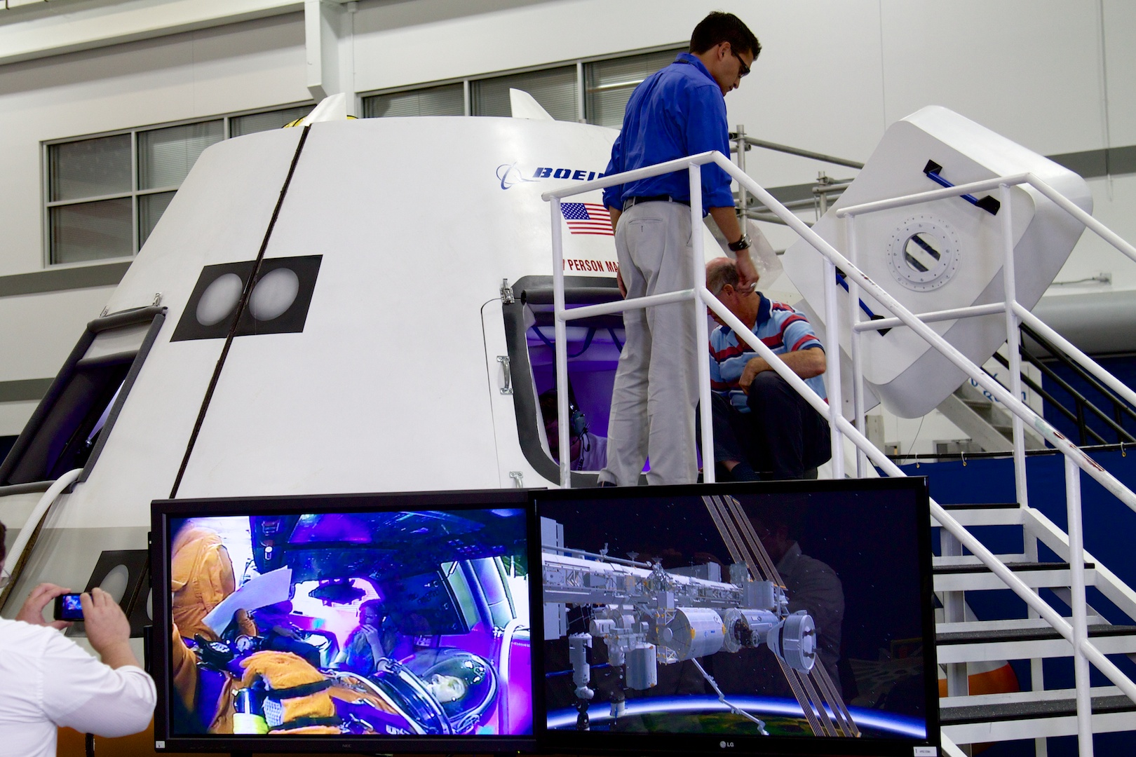 Watching astronaut Auñón on the monitors placed outside the mockup.